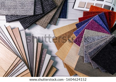 flooring and furniture materials - colorful floor carpet and wooden laminate samples