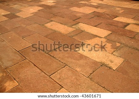 Flooring laid up with neatly dressed stone slabs