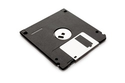 Floppy disk from black plastic isolated on white background. Outdated technology. Data storage diskette.