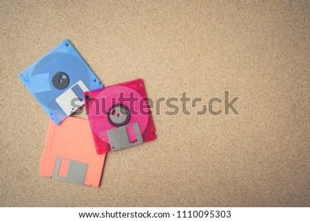 Floppy disk on a wood board.