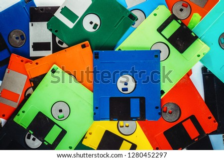 floppy disks background in the different colors