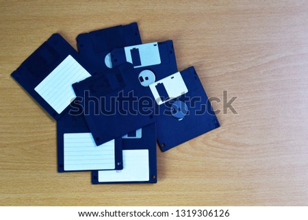 floppy disks on a wooden table
