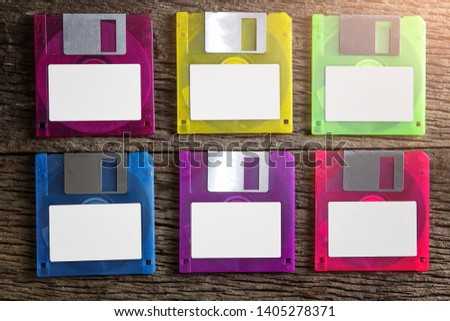 Floppy disks on a wooden table background. #1405278371