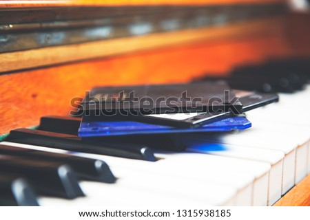 floppy disks on the piano keyboard background