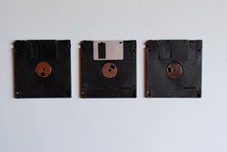 Floppy disks on white background. Old technology. Obsolete.