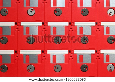 Floppy disks, red diskettes placed next to each other, seen from above