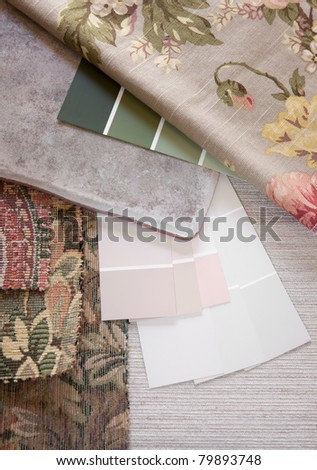 Floral and pastel paint color and fabric swatches with a floor tile