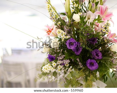 stock photo Floral arrangement at outdoor tent wedding
