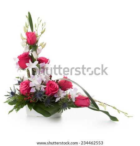 Floral arrangement made of Roses, Orchids and Eryngium flowers.