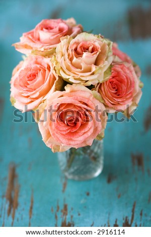 Floral arrangement of pink Roses in vase