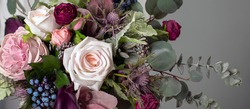 floral background. A long floral banner. Floristics. Purple and green. Colorful bouquet in cool colors.