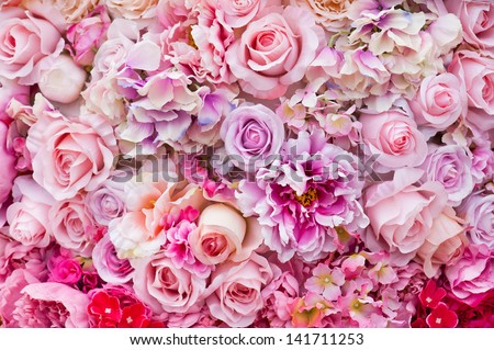 Floral background. Lot of artificial flowers in colorful composition