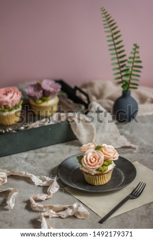 Floral cupcakes in fancy setting. #1492179371