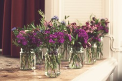 Floral decoration - Bouquets of mixed flowers in the jars.