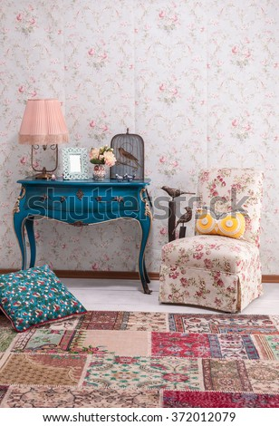 floral design wall paper desk and patchwork chair classic interior style