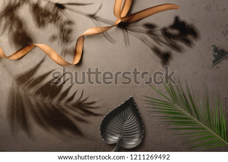 Floral elements and floral shadows overlays, leaves, flowers, herbs, palm leaves, grass top view and blank copy space on dark background. #1211269492