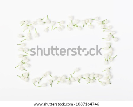Floral frame made of lily of the valley isolated on white background. Top view. Flat lay.