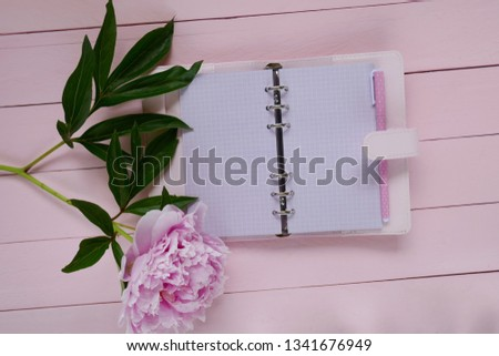 floral Mockup.floral layout. Blank pink notebook and  peony flower on pink wooden  background.Flat lay.Spring to-do list.top view, copy space.Spring mood #1341676949