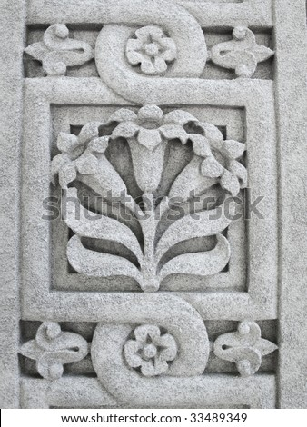 Floral pattern etched in stone