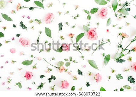 Floral pattern made of pink and beige roses, green leaves, branches on white background. Flat lay, top view. Valentine's background #568070722