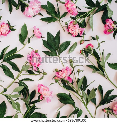 Floral pattern made of pink peonies, green leaves, branches on white background. Flat lay, top view. Valentine's background. Floral background. Pattern of flowers. #696789100