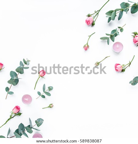 Floral pattern made of pink roses, green leaves eucalyptus, branches on white background. Flat lay, top view. Valentine's background. Floral pattern. Pattern of flowers. Flowers pattern texture