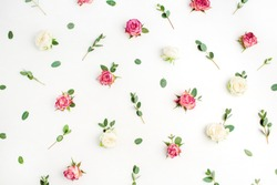 Floral pattern made of red and white rose flower buds and eucalyptus branches on white background. Fat lay, top view flowers background.