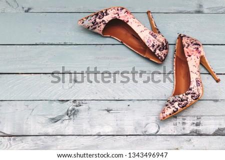 floral pump hight heeled on blue wood table #1343496947