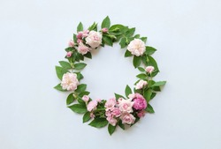 Floral round crown(wreath) with pink rose and leaves