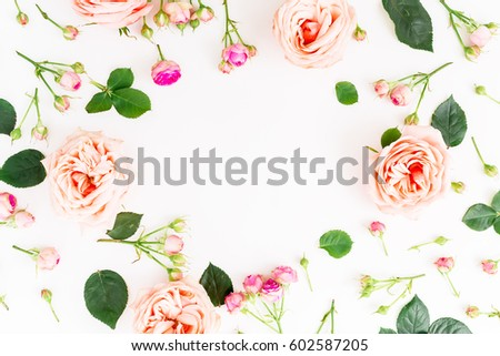 Floral round frame with pink roses and leaves on white background. Flat lay, top view. Frame background #602587205