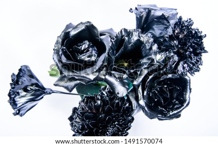 Floral shop. Flower covered metallic paint. Metal flower. Abstract art. Eternal beauty. Fashion bouquet. Botany concept. Forging and sculpture. Beautiful black silver flower. Metallic steel color.