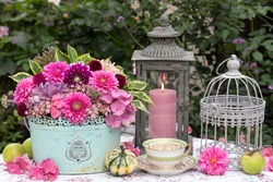 floral vintage arrangement with bouquet in pink, coffee cup and lantern French words mean vegetable garden