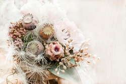 Floral winter romantic Christmas background with pale pink flowers in vintage style. Wedding background with a delicate bouquet in soft colors Set Sail Champagne.