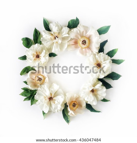 floral wreath frame with white peony flowers and green leaves on white background. Flat lay, top view