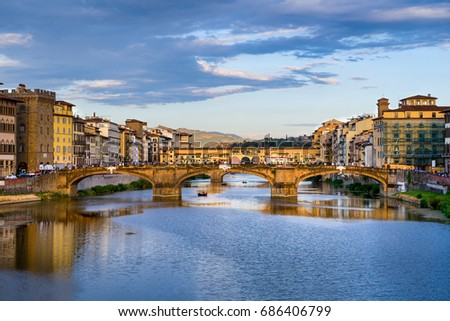 Florence cityscape view with Ponte Vecchio, a medieval stone bridge over Arno River. #686406799