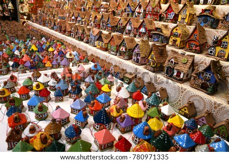 Florence, 2 December 2017: Christmas Ornaments in a Christmas Market. colored lined little houses in a market, Italy. editorial image.