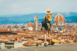 Florence Europe Italia travel summer tourism holiday vacation background -young  girl with camera in hand standing on the hill looking on the cathedral