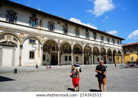 FLORENCE, ITALY - AUGUST 22, 2014: People walking on a square in the city center