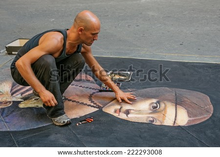 FLORENCE, ITALY - AUGUST  10, 2014: unknown artist  draws a  Lady with an Ermine (from  Leonardo da Vinci ) on the pavement by chalk, Florence, Italy