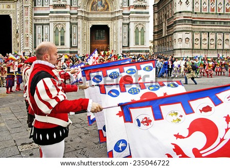 FLORENCE, ITALY - EASTER SUNDAY APRIL 16, 2006: Flag bearers walk in Easter parade wearing historical costumes on April 16, 2006, Florence, Italy. Celebration \