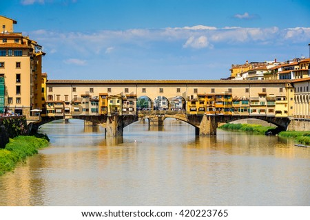 FLORENCE, ITALY - MAY 6, 2016: Ponte Vecchio (Old Bridge), a Medieval stone closed-spandrel segmental arch bridge over the Arno River, in Florence, Italy. #420223765