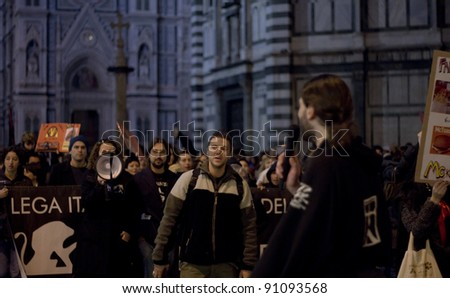 "FLORENCE, ITALY - NOVEMBER 27: Animal right demonstration against the company policy of fast-food chain McDonald's walk in ""Piazza del Duomo"" on November 27, 2011 in Florence (Italy)"