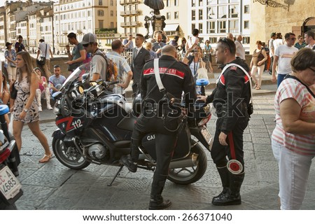 FLORENCE, ITALY - SEPTEMBER 09, 2014: Carabinieri work among the people crowd on Ponte Vecchio. It is the national military police of Italy, policing both military and civilian populations.