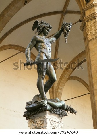 Florence, medieval heritage town in central Italy - Benvenuto Cellini's statue of Perseus with the head of Medusa cut (in the Loggia de' Lanzi)