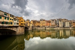 Florence, Medieval Ponte Vecchio (Old Bridge) and the River Arno, UNESCO world heritage site, Tuscany Italy, Europe.