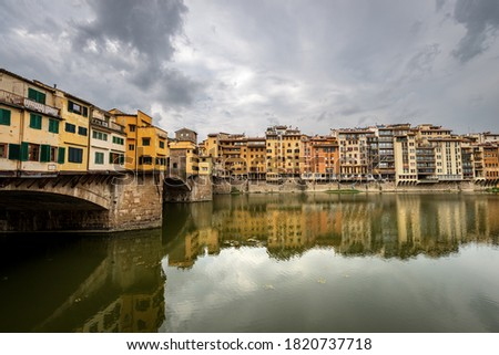 Florence, Medieval Ponte Vecchio (Old Bridge) and the River Arno, UNESCO world heritage site, Tuscany Italy, Europe. stock photo