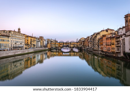 Florence, Medieval Ponte Vecchio (Old Bridge) and the River Arno,UNESCO world heritage site, Tuscany Italy, Europe. stock photo