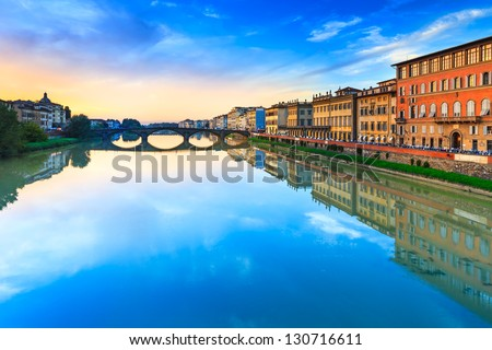 Florence, Ponte alla Carraia medieval Bridge landmark on Arno river, sunset landscape with reflection. It is the second oldest bridge, built in 1218, in the city. Tuscany, Italy. stock photo