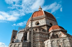 Florence's Cathedral - Duomo di Firenze. Close look at the church. Blue sky with clouds.