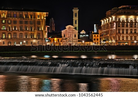 Florence, Tuscany, Italy: landscape at night of the city with the Arno river and the Church of Ognissanti